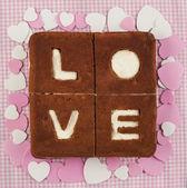 Love Cake. Chocolate banana cake with creamcheese frosting and world Love — Stock Photo