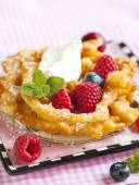 Funnel cakes with fresh berries and whipped cream — Stock Photo