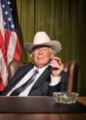 Big boss with white cowboy hat smoking cigar sitting behind desk — Stock Photo