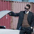 Retro 60s mafia business man with suit and black sunglasses look — Stock Photo #52632005