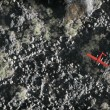 Aerial of red airplane flying over grey rock mountain landscape — Stock Photo #53055129