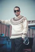 Retro fifties fashion man with woolen sweater and sunglasses sta — Stock Photo