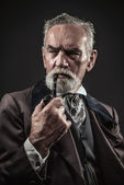 Pipe smoking vintage characteristic senior man with gray hair an — Stock Photo