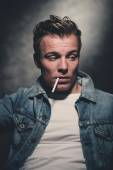 Cigarette smoking retro fifties cool rebellion fashion man weari — Stock fotografie