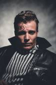 Retro fifties cool rebellion fashion man wearing striped woolen  — Foto de Stock