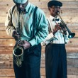 Two african american jazz musicians playing trumpet and saxophon — Stock Photo #57984067