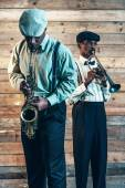Two african american jazz musicians playing trumpet and saxophon — Stock Photo