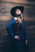 Cowgirl jeans fashion woman with long blonde hair. Standing agai — Stock Photo