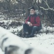 Senior man outdoors in winter woodland — Stock Photo #65074419