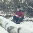 Elderly man in a snowy winter forest — Stock Photo #65074453