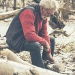 Old Man at the Forest Cooking for Food — Stock Photo #65074517