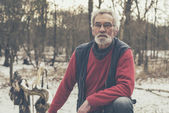 Old Man in Snowed Forest — Stock Photo