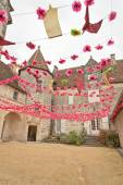 Bunting in the grounds of a stone castle — Stock Photo