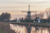 Windmill and farm houses — Stock Photo