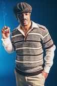Man standing smoking — Stock Photo