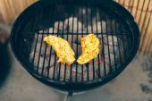 Two seasoned savory chicken breasts — Stock Photo