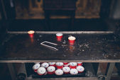 Burning red candles in a church interior — Stock Photo