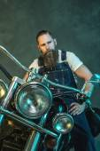 Bearded Man in Jumpsuit Sitting on his Motorcycle — Stock Photo