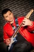 Handsome musician playing rock and roll the electric guitar — Foto Stock