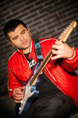 Handsome musician playing rock and roll the electric guitar — Foto de Stock