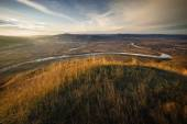 Landscape with meadow, hills and river — Stock Photo