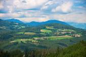 Alpine fields and villages landscape — Stock Photo