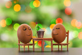 Funny eggs on a beach chair relaxing — Foto Stock