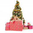 Woman inside of gift box and christmas tree behind — Stock Photo #57987919