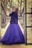Woman on a bridge with violet dress — Foto de Stock