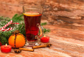 Christmas tree, mandarine, glogg and candles — Stock Photo