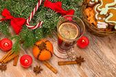 Christmas tree, mandarine, glogg and candles — Stock Photo
