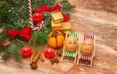 Funny eggs, Christmas, mandarin, gift and candles — Stock Photo