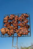 Grill meat and blue sky — Stock Photo
