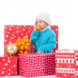 Funny little girl around christmas gift boxes — Stock Photo #62156549