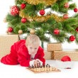 Child dressed as a gnome play chess — Stock Photo #62156557