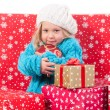 Funny little girl around christmas gift boxes — Stock Photo #62156563