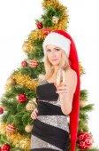 Beautiful blond smiling woman and Christmas tree. — Stock Photo