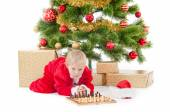 Child dressed as a gnome play chess — Stock Photo