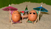 Easter funny eggs under umbrella — Stock Photo