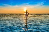 Woman in white bikini posing in a sea — Stock Photo