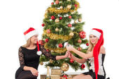 Beautiful blond smiling women with christmas tree — Stock Photo