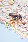 The Roman she-wolf on an Italy map — Stok fotoğraf