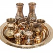 Set of decorative souvenirs from copper and bronze on a tray — Stock Photo #67343207