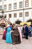 Courtyard of the castle, ladies and gentlemen in the costumes of — Stock Photo