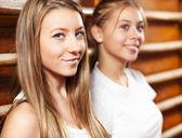 Two cute teenage girl on gymnastic training — Stock Photo