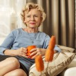 Blonde senior woman resting at home. — Stock Photo #63690249