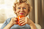 Blonde senior woman resting at home. Close up. — Stock Photo