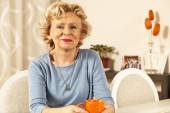 Blonde senior woman resting at home. — Stock Photo