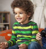Young boy playing video game, at home. — Stock Photo