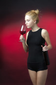 Beauty blon model and red wine  — Stock Photo